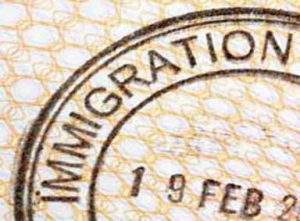 Immigration entry stamp on the inside page of a passport (XL)