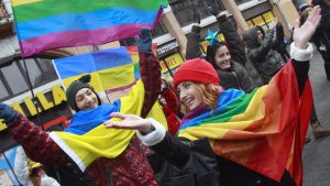 People take part in a procession organised by gay rights activists in central Kiev