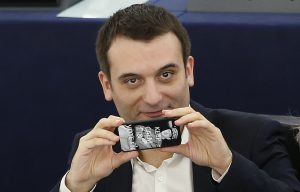 France's far-right National Front political party member and member of the European Parliament Philippot uses his mobile phone to take pictures of press photographers ahead of a voting session in Strasbourg
