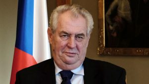 President Milos Zeman gestures while speaking during an interview with Reuters at Prague Castle