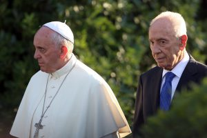 VATICAN CITY, VATICAN - JUNE 08: Pope Francis (L) meets Israeli President Shimon Peres for a peace invocation prayer at the Vatican Gardens on June 8, 2014 in Vatican City, Vatican. Pope Francis invited Israeli President Shimon Peres and Palestinian President Mahmoud Abbas to the encounter on May 25th during his visit to the Holy Land. (Photo by Franco Origlia/Getty Images)