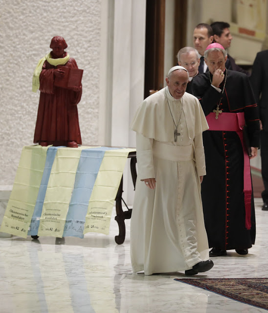 Pope Francis arrives for an audience with Lutheran pilgrims in the Paul VI Hall at the Vatican, Thursday, Oct. 13, 2016. (AP Photo/Alessandra Tarantino)