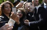 French newly elected president Emmanuel Macron (R) poses for pictures with supporters on May 10, 2017 at the Jardins du Luxembourg in Paris during a ceremony to mark the anniversary of the abolition of slavery and to pay tribute to the victims of the slave trade. / AFP PHOTO / POOL AND AFP PHOTO / Eric FEFERBERG
