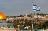 "An Israeli flag flutters on the roof of a buiding of the Jewish Quarter in the Old City of Jerusalem opposite the Dome of the Rock (L) in the Al-Aqsa mosque compound, on December 5, 2017. The EU's diplomatic chief Federica Mogherini said that the status of Jerusalem must be resolved ""through negotiations"", as US President Donald Trump mulls recognising the city as the capital of Israel. / AFP / THOMAS COEX"